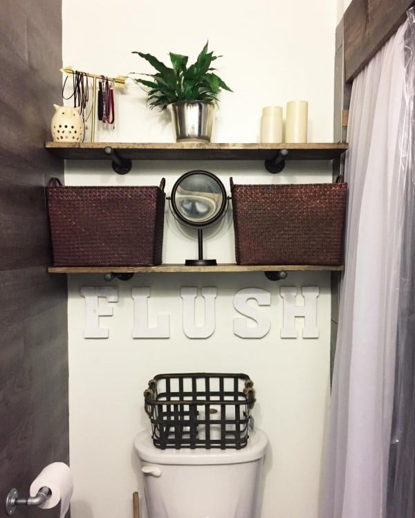 100 Cozy Rustic Farmhouse Bathroom Decor Ideas You Can Easily Copy - Check out this #rustic bathroom decor idea with a flush wall sign and open shelving. Love it! #BathroomDesign #HomeDecorIdeas