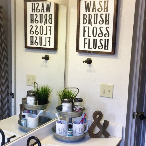 100 Cozy Rustic Farmhouse Bathroom Decor Ideas You Can Easily Copy - Check out this #rustic bathroom decor idea with a wall sign. Love it! #BathroomDesign #HomeDecorIdeas