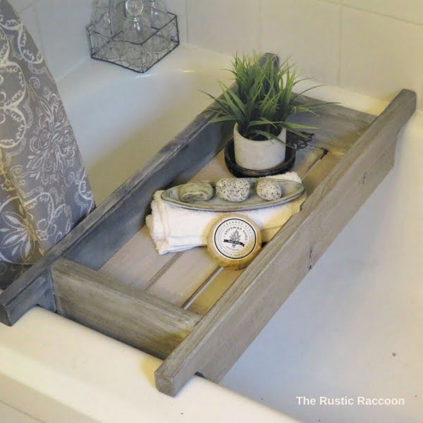 100 Cozy Rustic Farmhouse Bathroom Decor Ideas You Can Easily Copy - Check out this #rustic bathroom decor idea with a wooden bath caddy. Love it! #BathroomDesign #HomeDecorIdeas