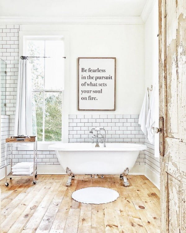 100 Cozy Rustic Farmhouse Bathroom Decor Ideas You Can Easily Copy - Check out this #rustic bathroom decor idea with subway tile and a wall sign. Love it! #BathroomDesign #HomeDecorIdeas