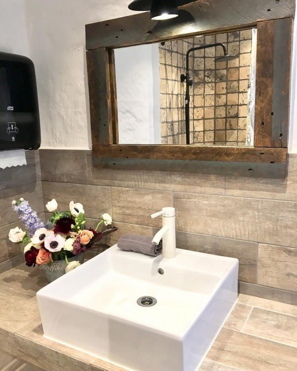100 Cozy Rustic Farmhouse Bathroom Decor Ideas You Can Easily Copy - Check out this  bathroom decor idea with wood plank tiles. Love it!