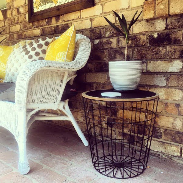 You have to see this shabby chic outdoor space decor idea with a thrift store basket table. Love it!