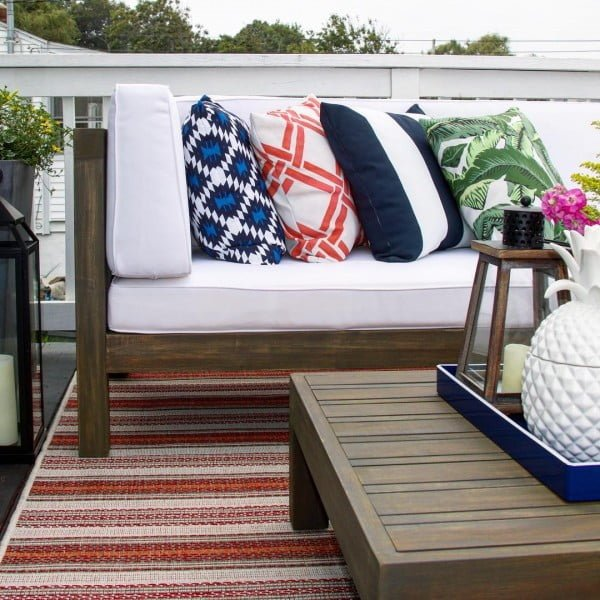 You have to see this shabby chic outdoor space decor idea with pattern accent pillows. Love it!