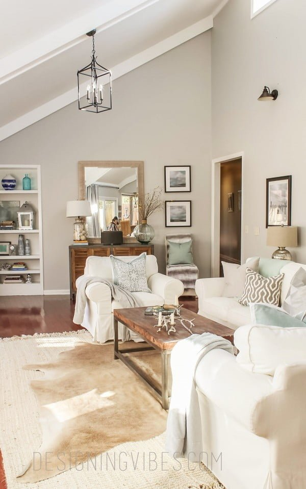 living room decor idea with a cowhide rug. Love it!