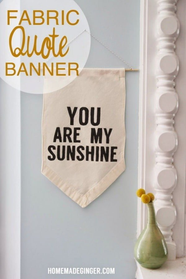 Check out the tutorial on how to make a  fabric quote banner. Looks easy enough!