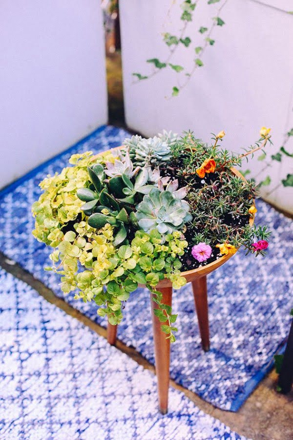 Great idea! Check out the tutorial on how to make a  tripod garden planter