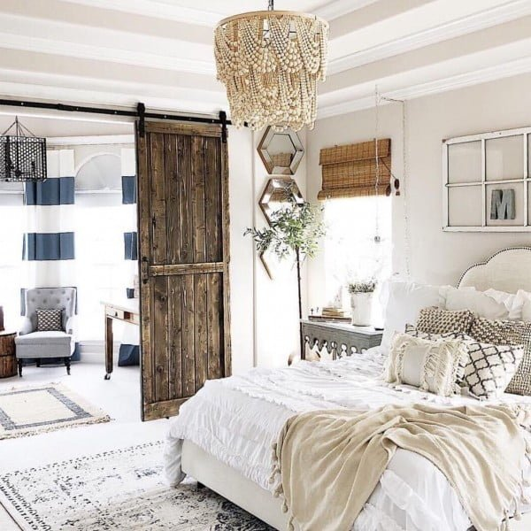 You have to see this #farmhouse bedroom decor idea with a beaded chandelier. Love it! #BedroomIdeas #HomeDecorIdeas