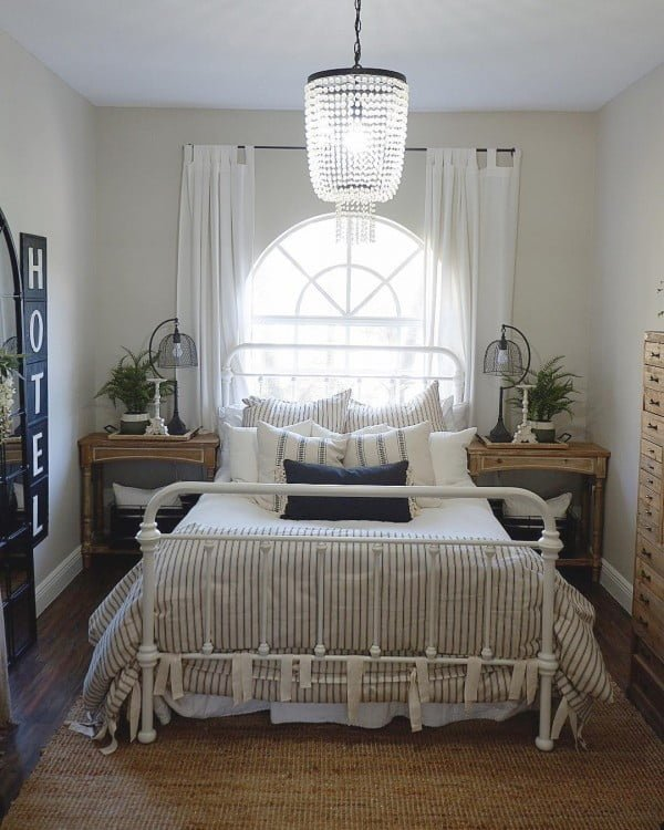 You have to see this #farmhouse bedroom decor idea with a crystal chandelier. Love it! #BedroomIdeas #HomeDecorIdeas