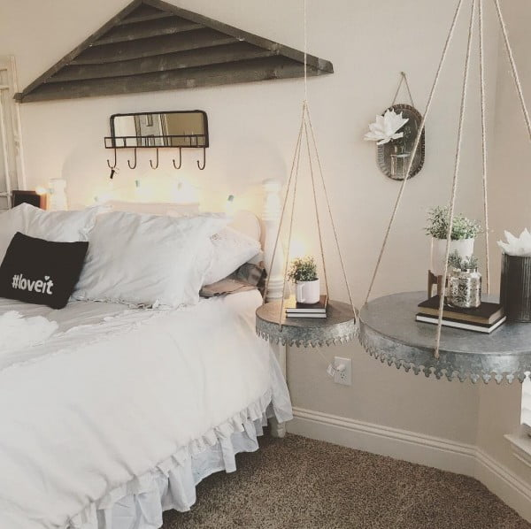You have to see this #farmhouse bedroom decor idea with hanging tables. Love it! #BedroomIdeas #HomeDecorIdeas