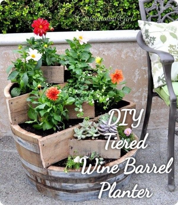 Great idea! Check out the tutorial on how to make a  tiered wine barrel garden planter