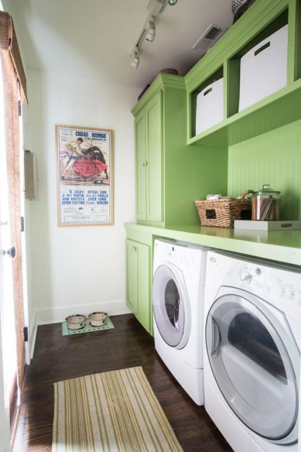 100 Fabulous Laundry Room Decor Ideas You Can Copy - You have to see this laundry room decor idea with green cabinets and wall art. Love it! #LaundryRoomDesign #HomeDecorIdeas