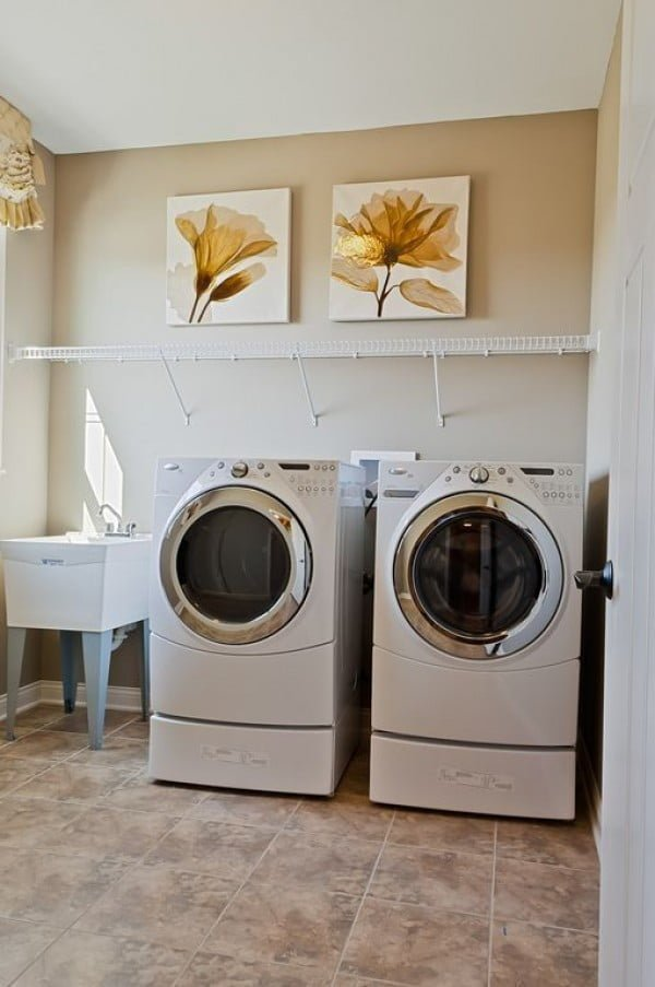 100 Fabulous Laundry Room Decor Ideas You Can Copy - You have to see this laundry room decor idea with wall art. Love it!