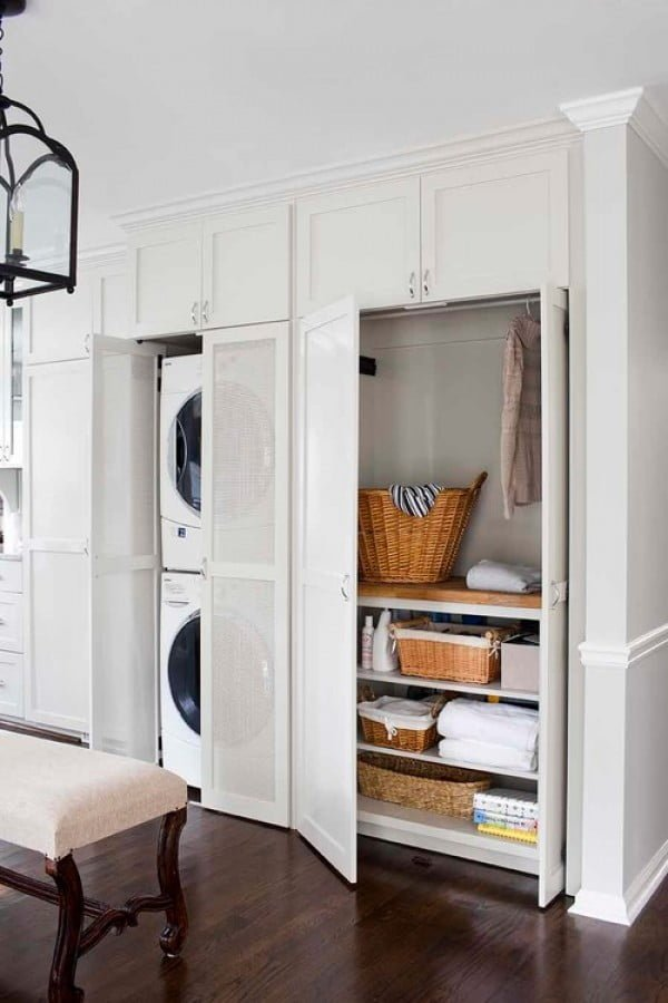100 Fabulous Laundry Room Decor Ideas You Can Copy - You have to see this laundry room decor idea with slide door cabinets. Love it! #LaundryRoomDesign #HomeDecorIdeas