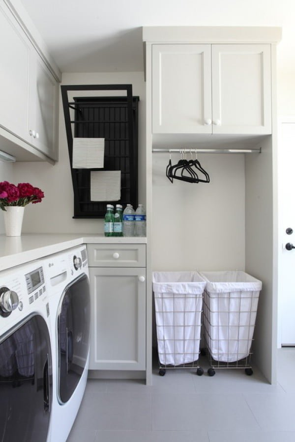 100 Fabulous Laundry Room Decor Ideas You Can Copy - You have to see this laundry room decor idea with a hanging nook. Love it! #LaundryRoomDesign #HomeDecorIdeas