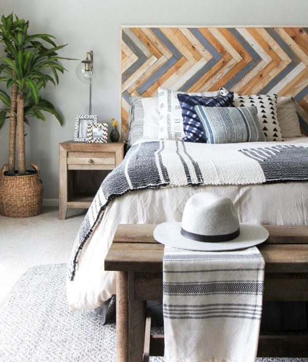 Check out this tutorial on how to make a  herringbone wood headboard. Looks easy enough!