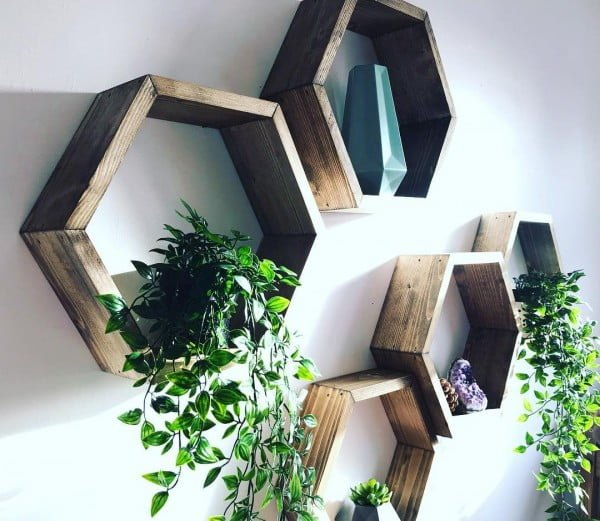 You have to see this #rustic wall decor idea with hexagonal shelves. Love it! #HomeDecorIdeas