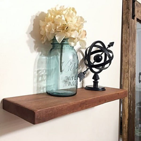 You have to see this #rustic wall decor idea with mason jars. Love it! #HomeDecorIdeas