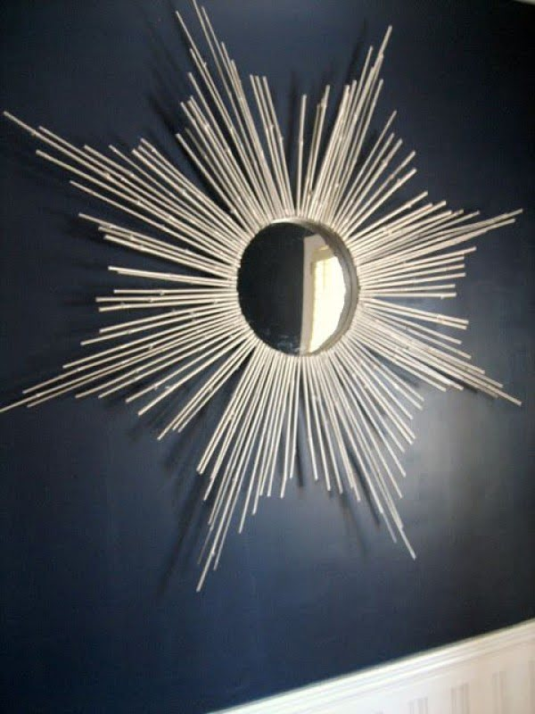 Check out the tutorial on how to make a  bamboo sunburst mirror. Looks easy enough!