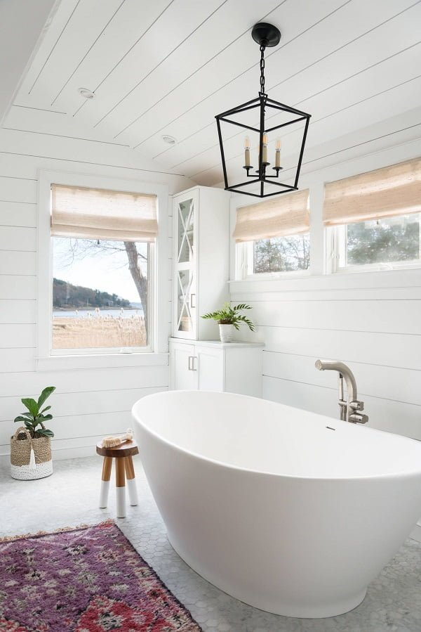 100 Cozy Rustic Farmhouse Bathroom Decor Ideas You Can Easily Copy - You have to see this bathroom decor idea with mosaic bathroom floor and white decor elements. Love it!