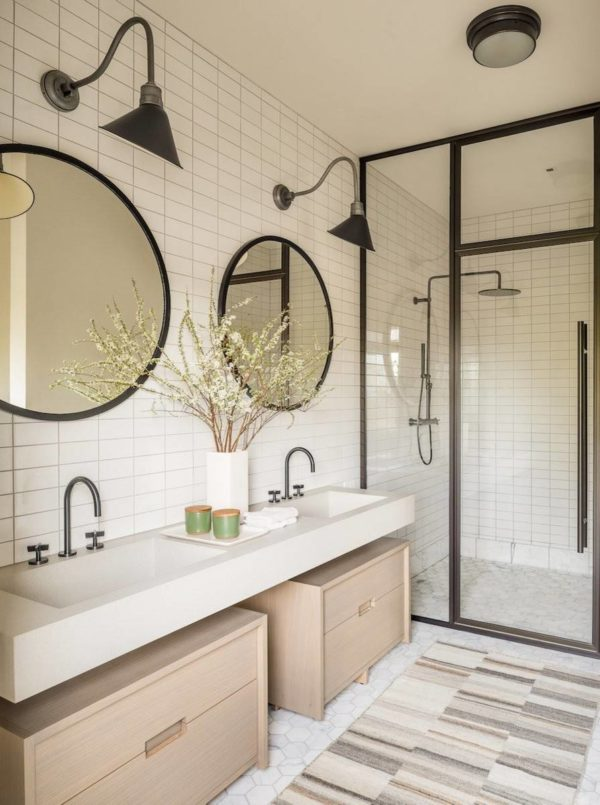 100 Cozy Rustic Farmhouse Bathroom Decor Ideas You Can Easily Copy - You have to see this #farmhousebathroom decor idea with light wood cabinets, hinged shower door and patterned carpeting. Love it! #BathroomDecor #HomeDecorIdeas