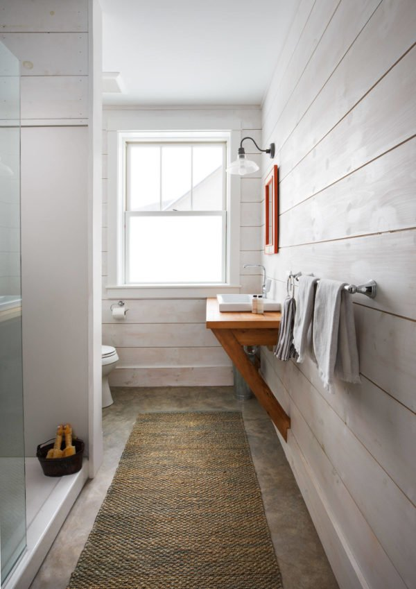 100 Cozy Rustic Farmhouse Bathroom Decor Ideas You Can Easily Copy - You have to see this bathroom decor idea with wooden plank walls and drop-in sink. Love it!