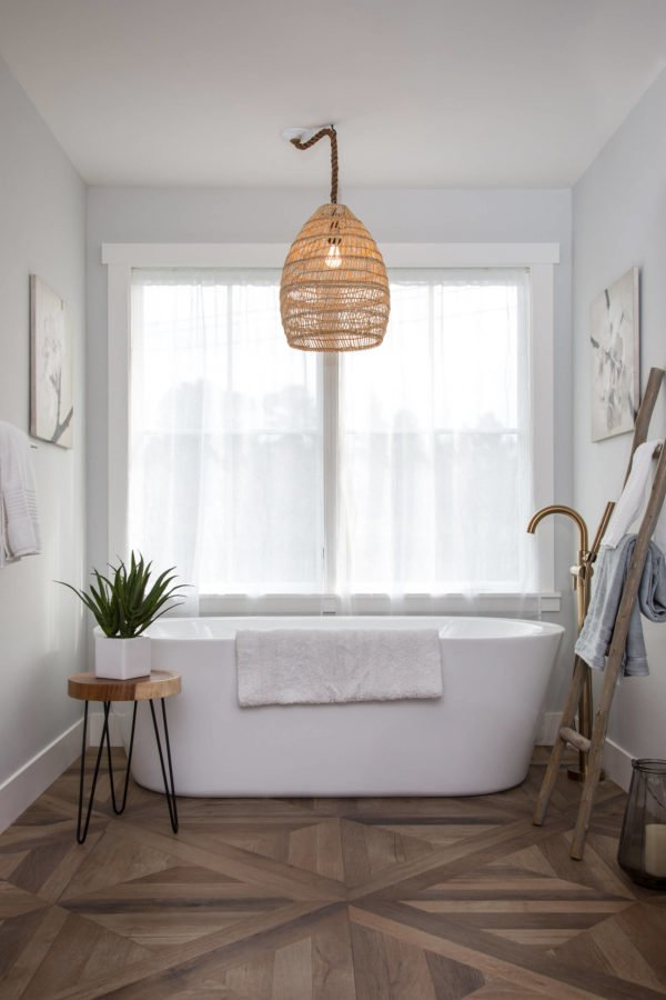 100 Cozy Rustic Farmhouse Bathroom Decor Ideas You Can Easily Copy - You have to see this #farmhousebathroom decor idea with freestanding bathtub and doubled external window. Love it! #BathroomDecor #HomeDecorIdeas