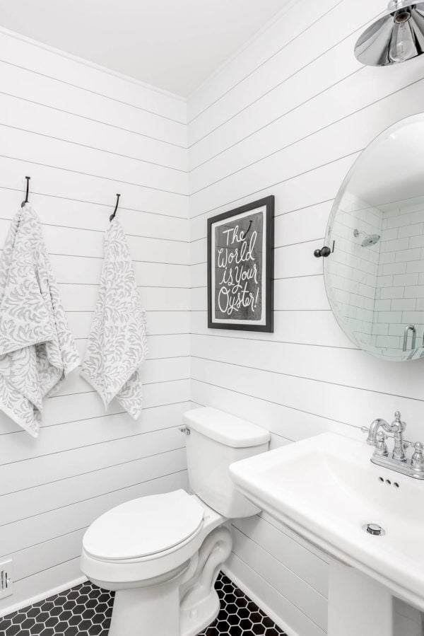 100 Cozy Rustic Farmhouse Bathroom Decor Ideas You Can Easily Copy - You have to see this #farmhousebathroom decor idea with a black and white mosaic tile floor and tall sink. Love it! #BathroomDecor #HomeDecorIdeas