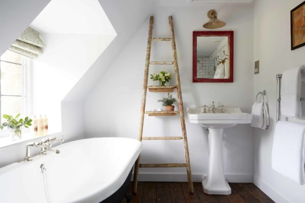 100 Cozy Rustic Farmhouse Bathroom Decor Ideas You Can Easily Copy - You have to see this #farmhousebathroom decor idea with ladder-like shelves and wooden flooring. Love it! #BathroomDecor #HomeDecorIdeas