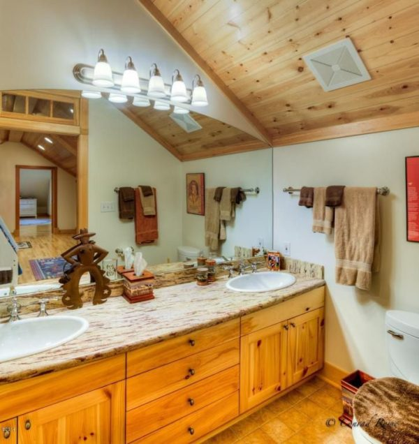100 Cozy Rustic Farmhouse Bathroom Decor Ideas You Can Easily Copy - You have to see this #farmhousebathroom decor idea with double porcelain sink and glamurous, overt-the-mirror lights. Love it! #BathroomDecor #HomeDecorIdeas