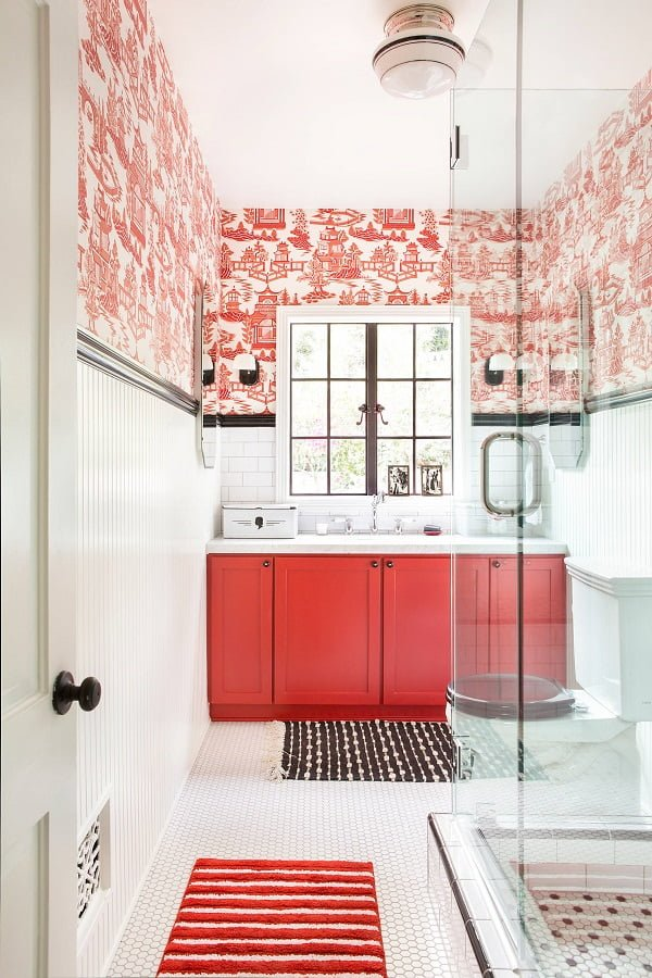100 Cozy Rustic Farmhouse Bathroom Decor Ideas You Can Easily Copy - You have to see this #farmhousebathroom decor idea with bright red cabinets and a two-piece toilet. Love it! #BathroomDecor #HomeDecorIdeas