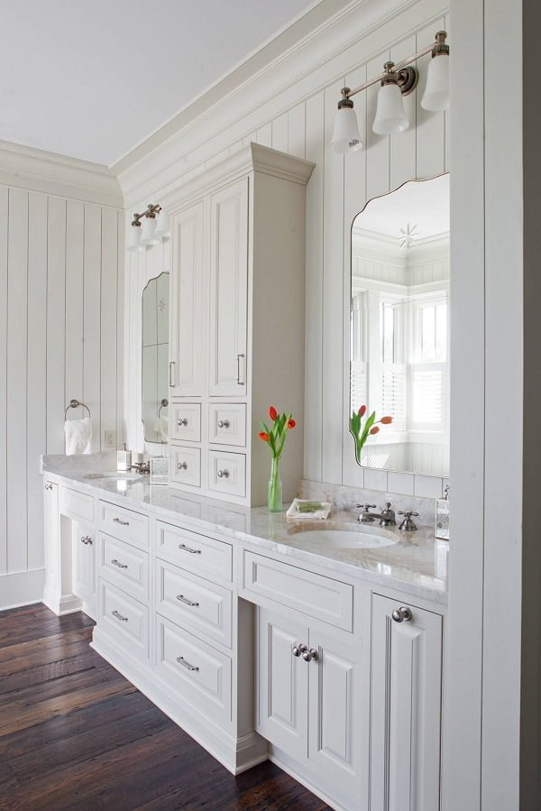 100 Cozy Rustic Farmhouse Bathroom Decor Ideas You Can Easily Copy - You have to see this #farmhousebathroom decor idea with raised-panel cabinets and separated mirror-sink sets. Love it! #BathroomDecor #HomeDecorIdeas