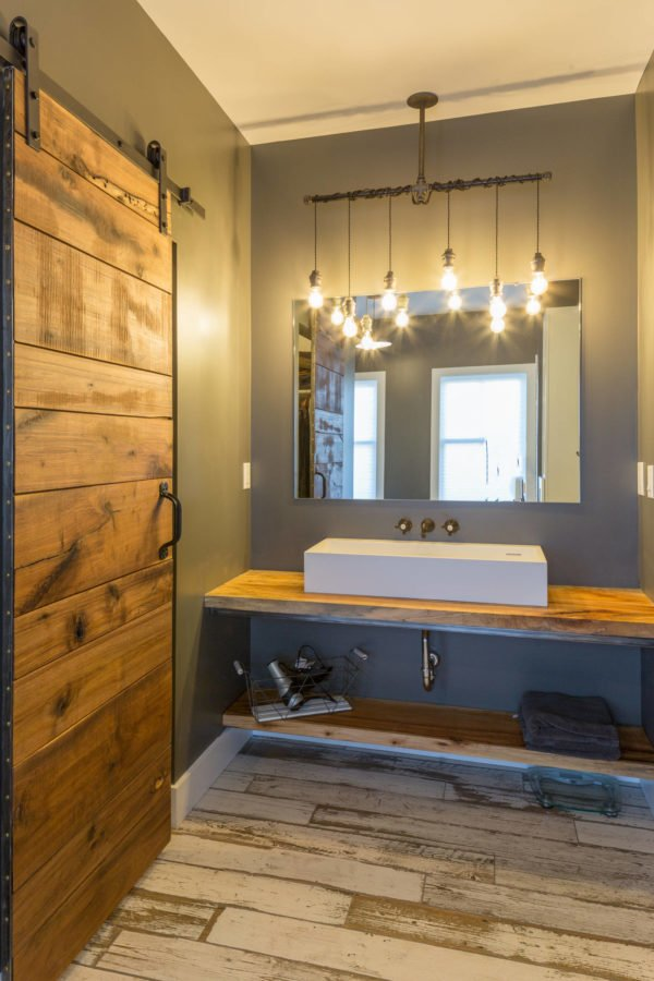 100 Cozy Rustic Farmhouse Bathroom Decor Ideas You Can Easily Copy - You have to see this #farmhousebathroom decor idea with discrete lighting and exposed white sink. Love it! #BathroomDecor #HomeDecorIdeas
