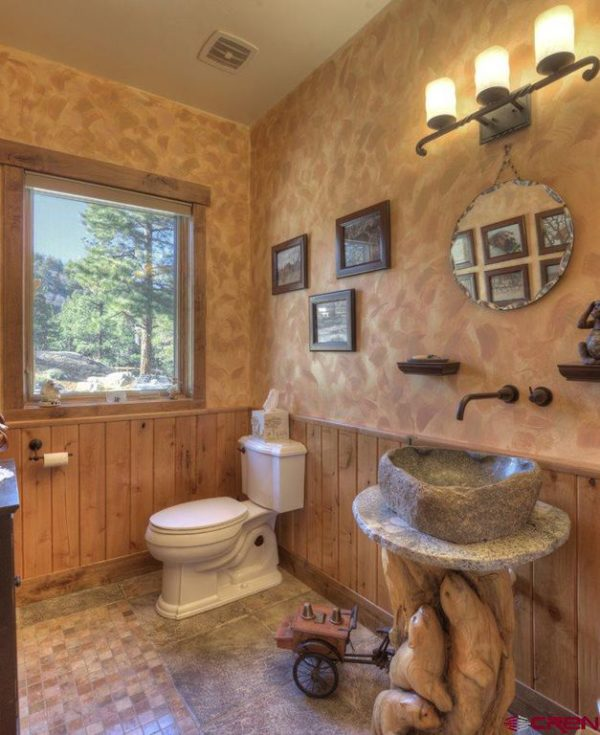 100 Cozy Rustic Farmhouse Bathroom Decor Ideas You Can Easily Copy - You have to see this #farmhousebathroom decor idea with cottage-like details and a sensational landscape window view. Love it! #BathroomDecor #HomeDecorIdeas