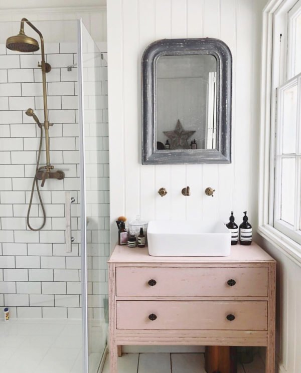 100 Cozy Rustic Farmhouse Bathroom Decor Ideas You Can Easily Copy - You have to see this #farmhousebathroom decor idea with brass shower head and bowl-inspired sink. Love it! #BathroomDecor #HomeDecorIdeas