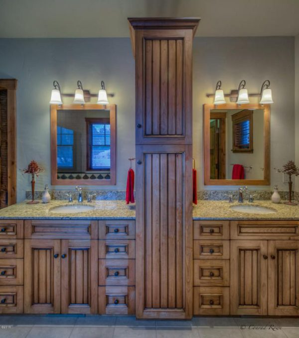 100 Cozy Rustic Farmhouse Bathroom Decor Ideas You Can Easily Copy - You have to see this bathroom decor idea with discrete lighting and spacisous wooden cabinets. Love it!