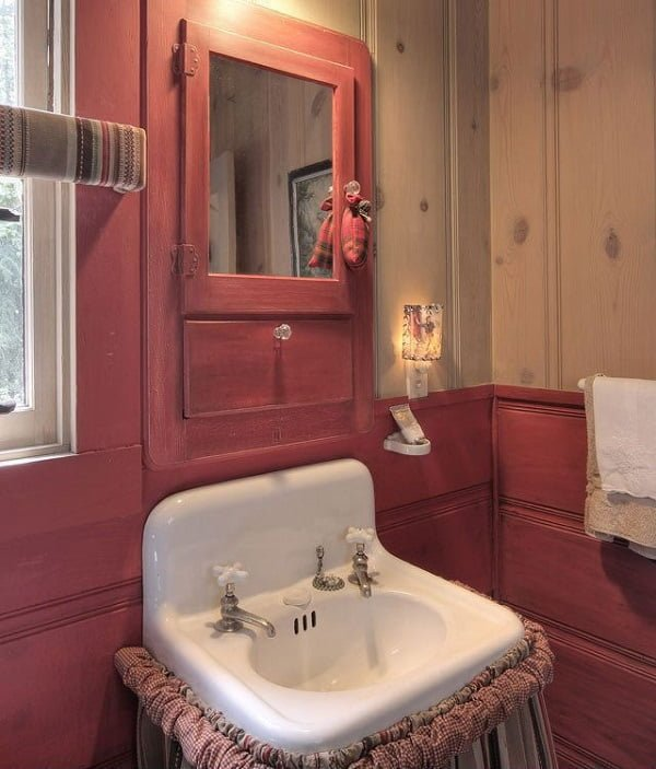 100 Cozy Rustic Farmhouse Bathroom Decor Ideas You Can Easily Copy - You have to see this bathroom decor idea with double-faucet sink and medical cabinet with a mirror. Love it!