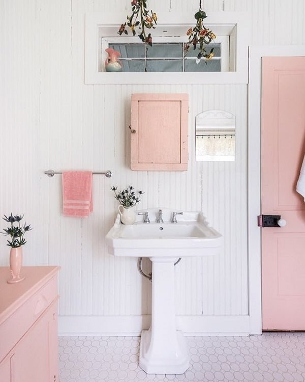 100 Cozy Rustic Farmhouse Bathroom Decor Ideas You Can Easily Copy - You have to see this bathroom decor idea with vintage pink medicine cabinet and high internal ventilating window. Love it!