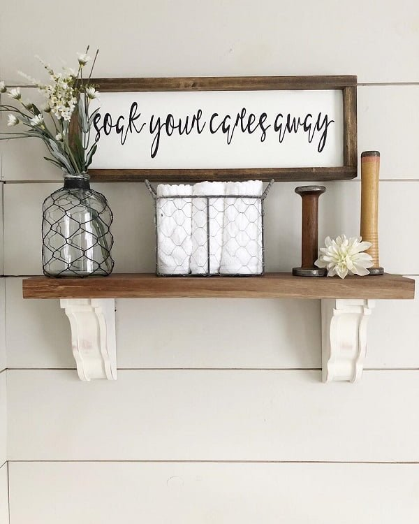 100 Cozy Rustic Farmhouse Bathroom Decor Ideas You Can Easily Copy - You have to see this bathroom decor idea with framed retro quote and ideal towel container. Love it!