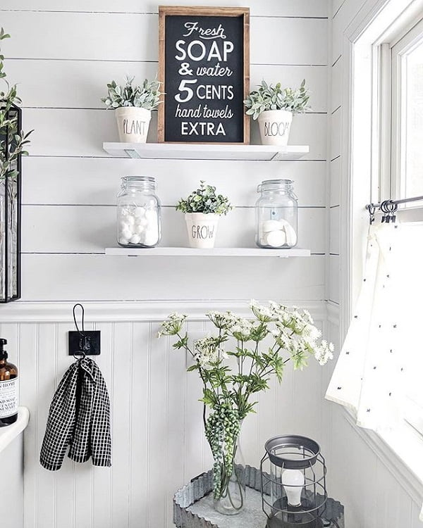 100 Cozy Rustic Farmhouse Bathroom Decor Ideas You Can Easily Copy - You have to see this #farmhousebathroom decor idea with patterned curtains and white plank walls. Love it! #BathroomDecor #HomeDecorIdeas