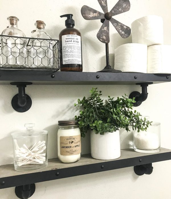 100 Cozy Rustic Farmhouse Bathroom Decor Ideas You Can Easily Copy - You have to see this #farmhousebathroom decor idea with glass jars and pipe-like shelf holders. Love it! #BathroomDecor #HomeDecorIdeas