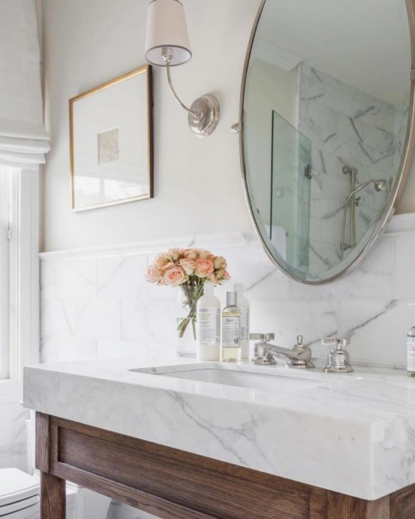 100 Cozy Rustic Farmhouse Bathroom Decor Ideas You Can Easily Copy - You have to see this bathroom decor idea with discrete lighting and hanlfway white marble wall. Love it!