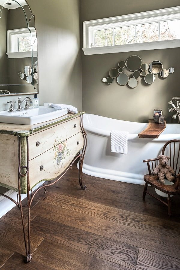 100 Cozy Rustic Farmhouse Bathroom Decor Ideas You Can Easily Copy - You have to see this #farmhousebathroom decor idea with drop-in sink and vintage night stand cabinet. Love it! #BathroomDecor #HomeDecorIdeas