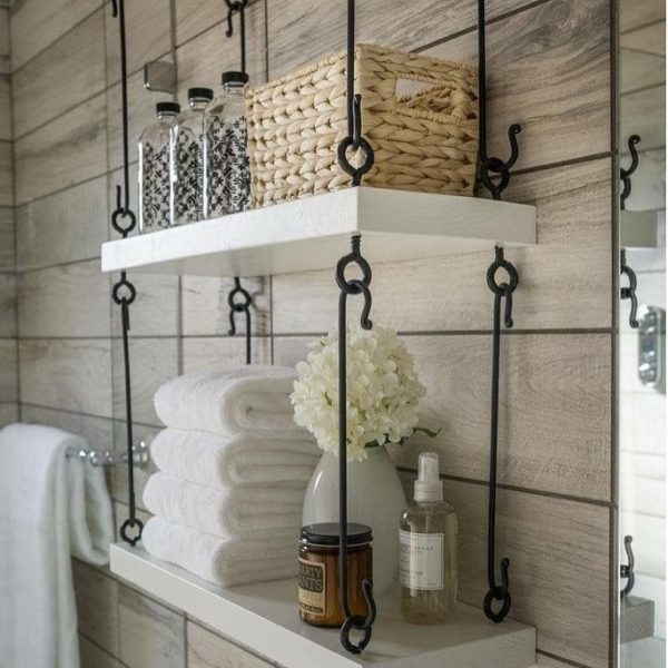 100 Cozy Rustic Farmhouse Bathroom Decor Ideas You Can Easily Copy - You have to see this bathroom decor idea with handpainted storage bottles and frameless silver mirror. Love it!