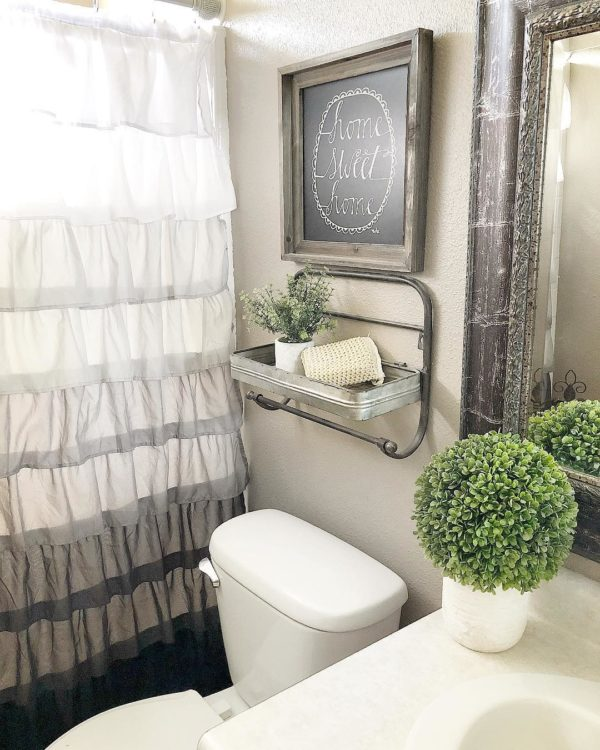 100 Cozy Rustic Farmhouse Bathroom Decor Ideas You Can Easily Copy - You have to see this #farmhousebathroom decor idea with framed rustic mirror and classic porcelain sink. Love it! #BathroomDecor #HomeDecorIdeas