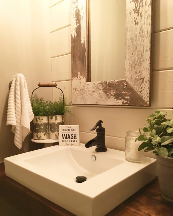 100 Cozy Rustic Farmhouse Bathroom Decor Ideas You Can Easily Copy - You have to see this bathroom decor idea with fashionable soap container and minimal towel hook. Love it!