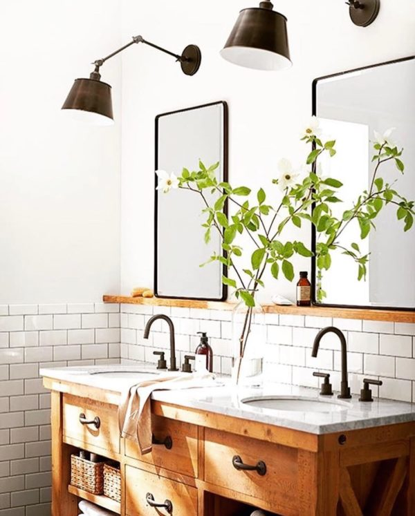 100 Cozy Rustic Farmhouse Bathroom Decor Ideas You Can Easily Copy - You have to see this #farmhousebathroom decor idea with wooden udner-mirror shelves and brick tile halfway wall. Love it! #BathroomDecor #HomeDecorIdeas