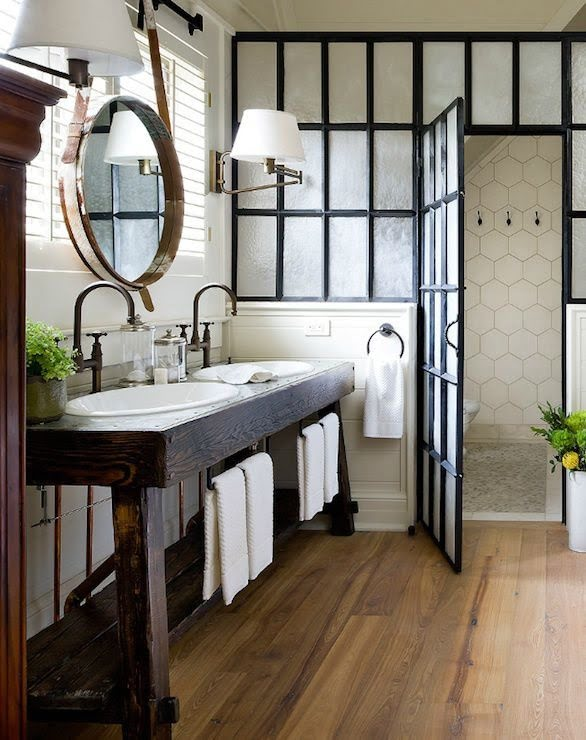 100 Cozy Rustic Farmhouse Bathroom Decor Ideas You Can Easily Copy - You have to see this #farmhousebathroom decor idea with centrally placed shower drain and knitted bathroom rug. Love it! #BathroomDecor #HomeDecorIdeas