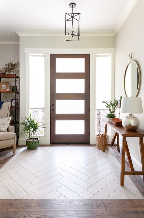 You have to see this #farmhouse decor idea with dark iron chandelier and hardwood-glass entrance door. Love it! #FarmhouseDecor #HomeDecorIdeas