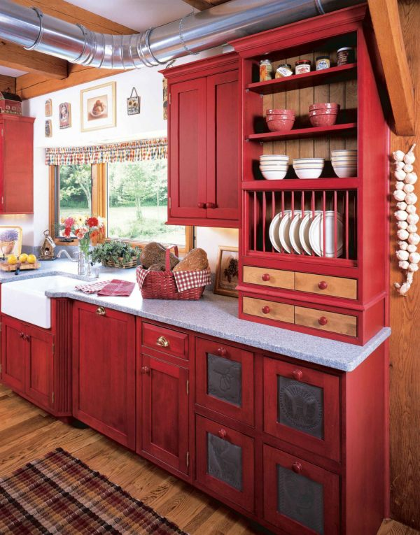 decor idea with red open and closed cabinets and handmade rustic carpet. Love it!