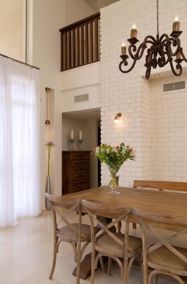 You have to see this #farmhouse decor idea with stunning skyscraper-like windows and no-door passages. Love it! #FarmhouseDecor #HomeDecorIdeas